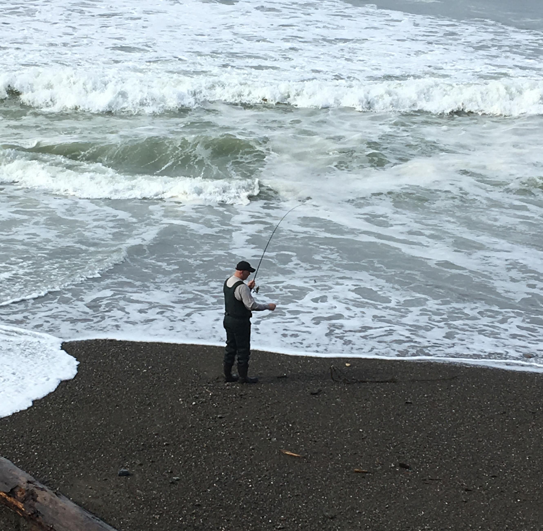 fisherman on ocean beach