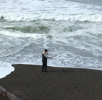 fisherman on ocean beach