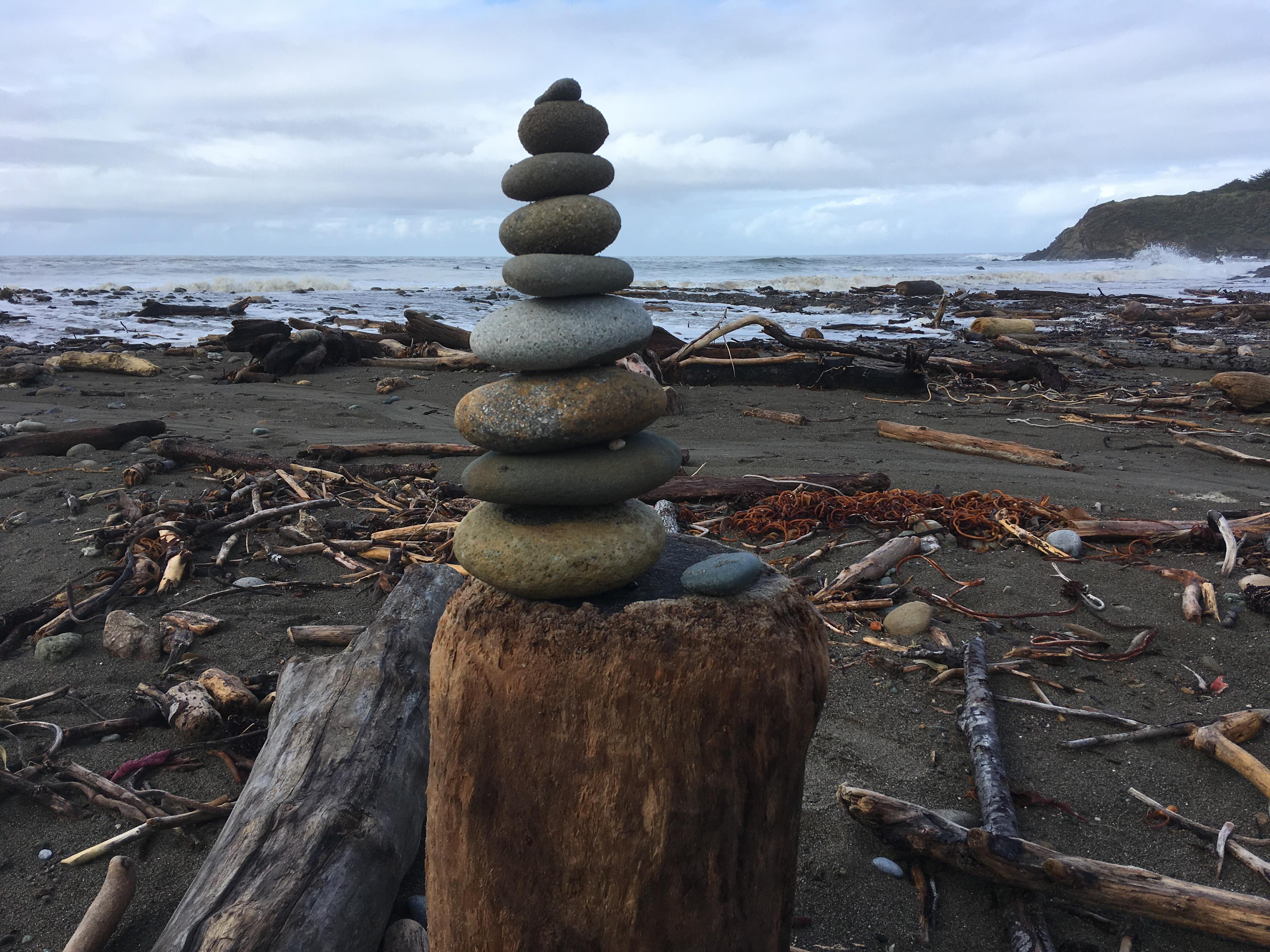 pile of rocks on ocean beach