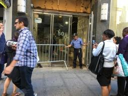 crowd beside office doorway in Brooklyn
