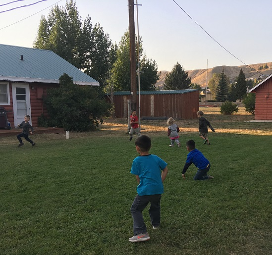 Kids playing in a back yard in Dubois WY
